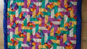 Dette er mit første patchworkprojekt, jeg lavede det til vores venners nyfødte søn i foråret 1996